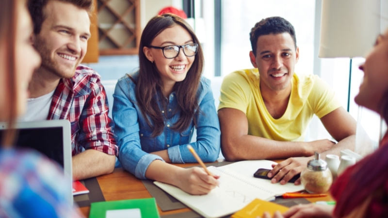 Happy teens spending leisure in cafe